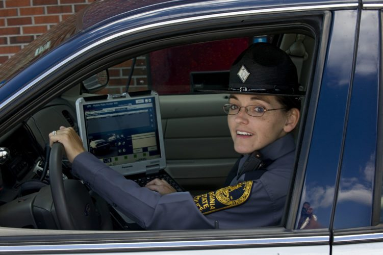 Virginia State Police trooper Pamela M. Neff demonstrates how to use the license plate reader in her cruiser. The reader is credited with locating shooting suspect Vester Lee Flanagan II's vehicle after it passed her cruiser, which was  parked at the interchange of Interstates 81 and 66 on Wednesday.  Rich Cooley/Daily